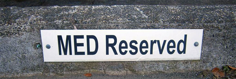 MED Reserved parking sign on curb