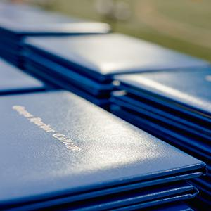 A stack of degrees to be handed out at the graduation ceremony